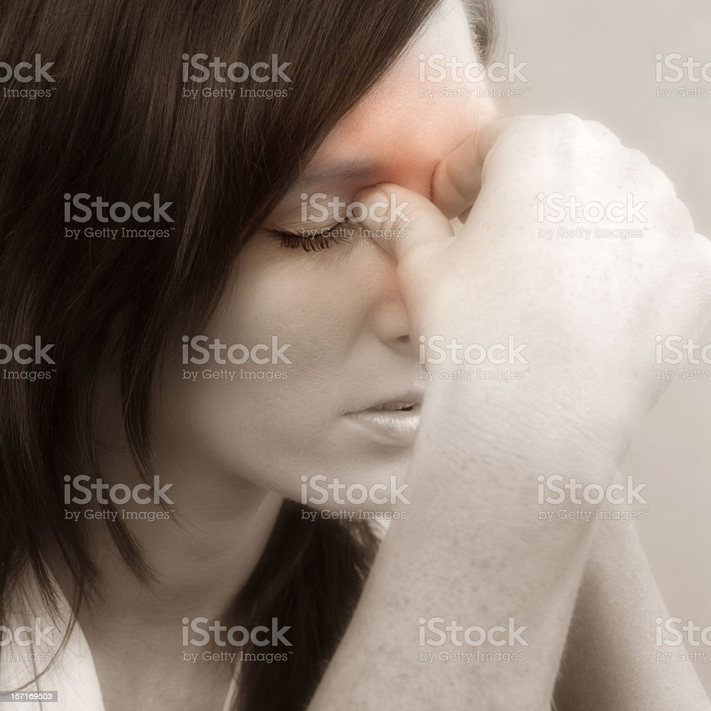 A woman with terrible sinus pain stock photo