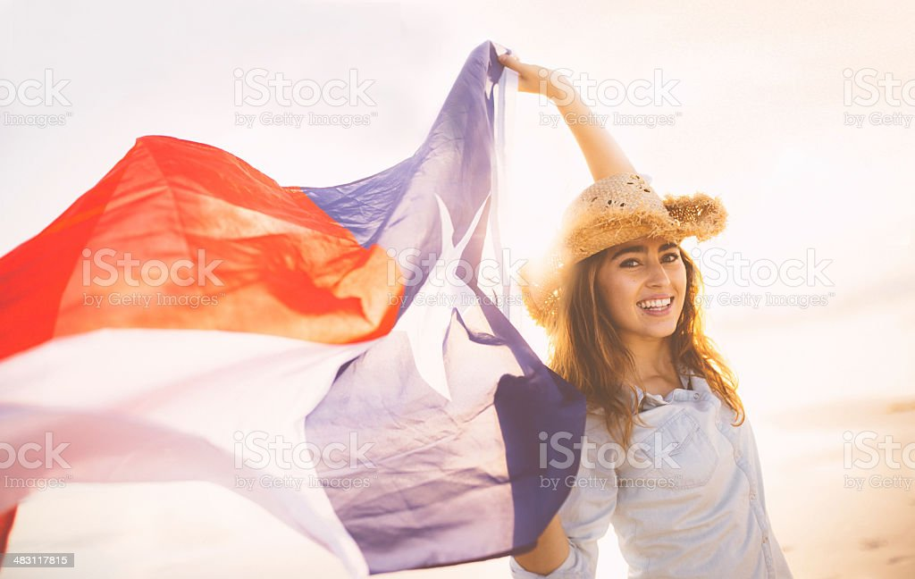 Woman with Texan flag waving in the wind stock photo