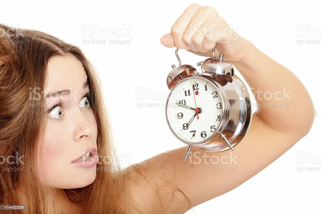 Woman with the alarm clock stock photo