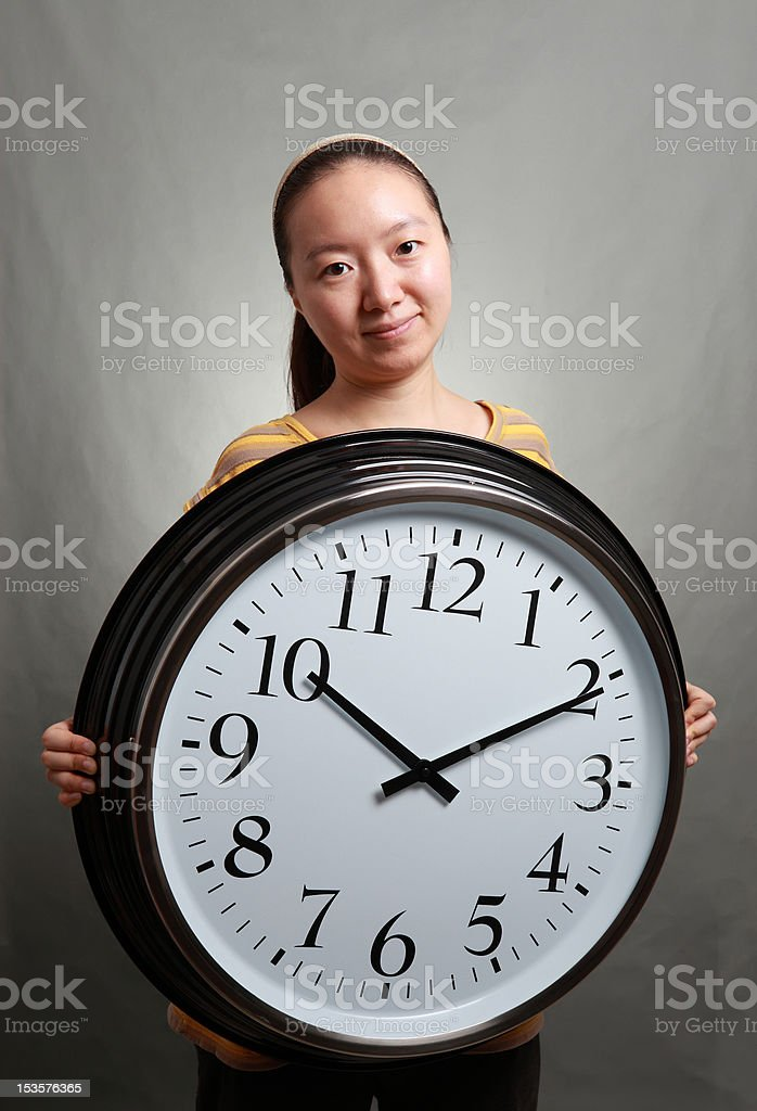 Woman with the alarm clock royalty-free stock photo