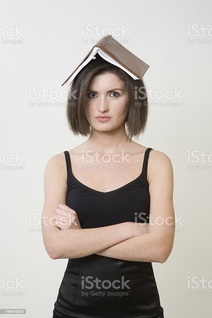 Woman with the book on a head royalty-free stock photo