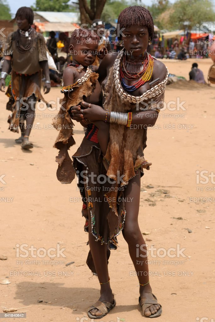 Woman with the children from Hamer people stock photo