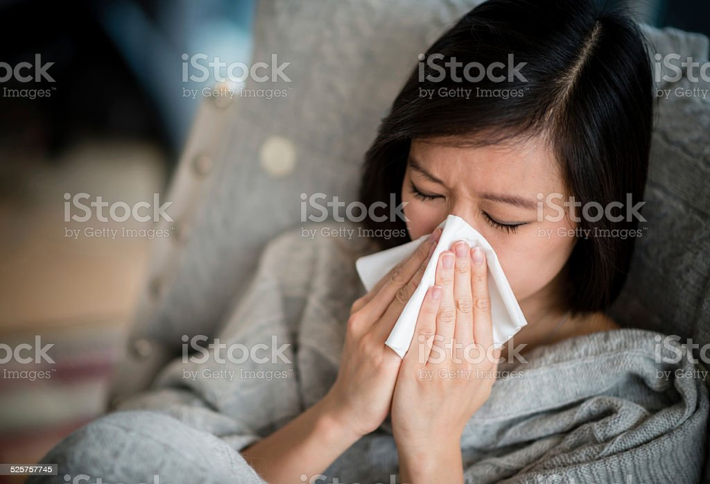 Woman with the flu stock photo
