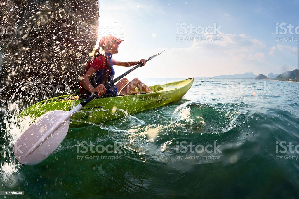 Woman with the kayak stock photo