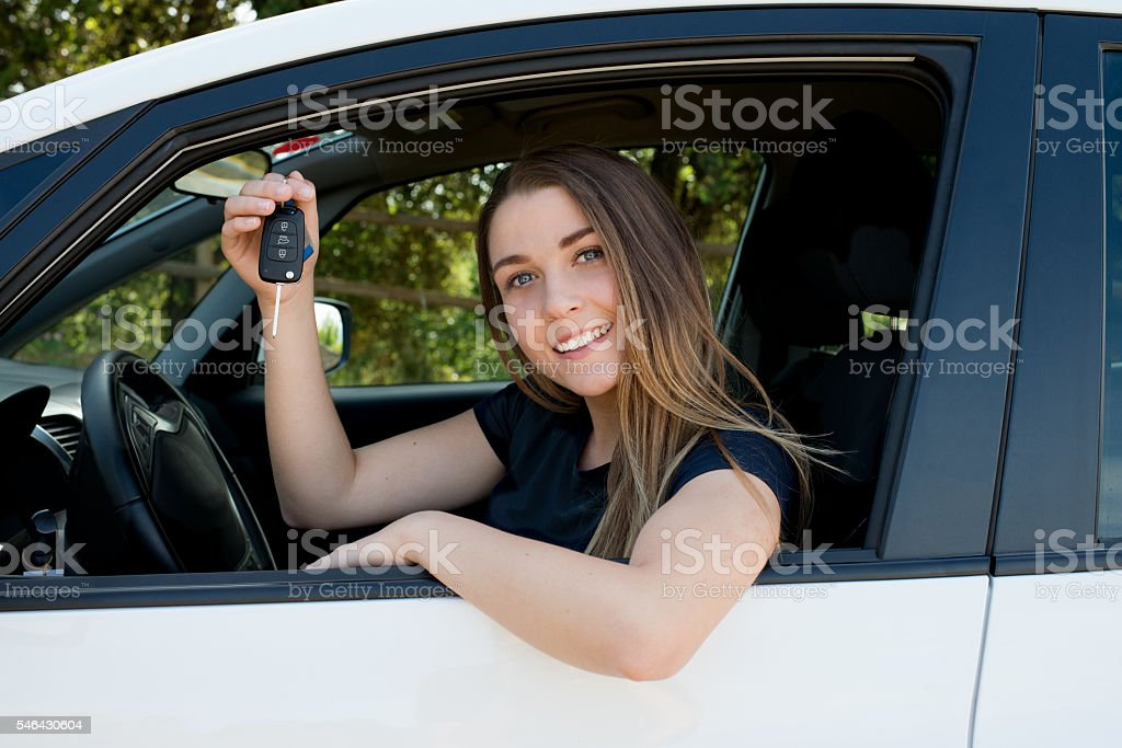 woman with the key of the car in the hand stock photo