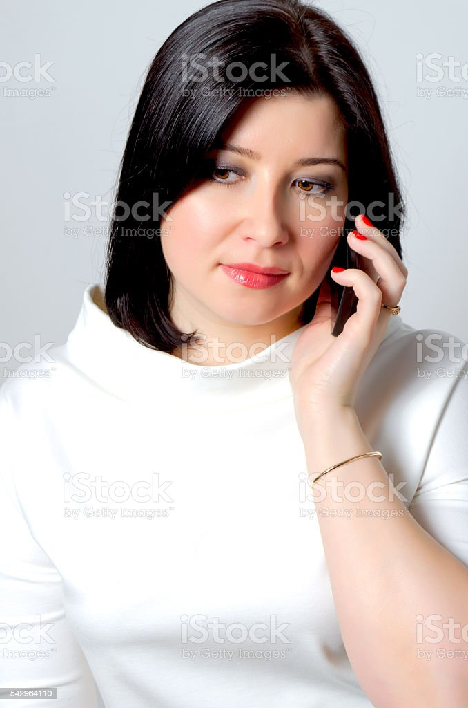 Woman with the phone. stock photo
