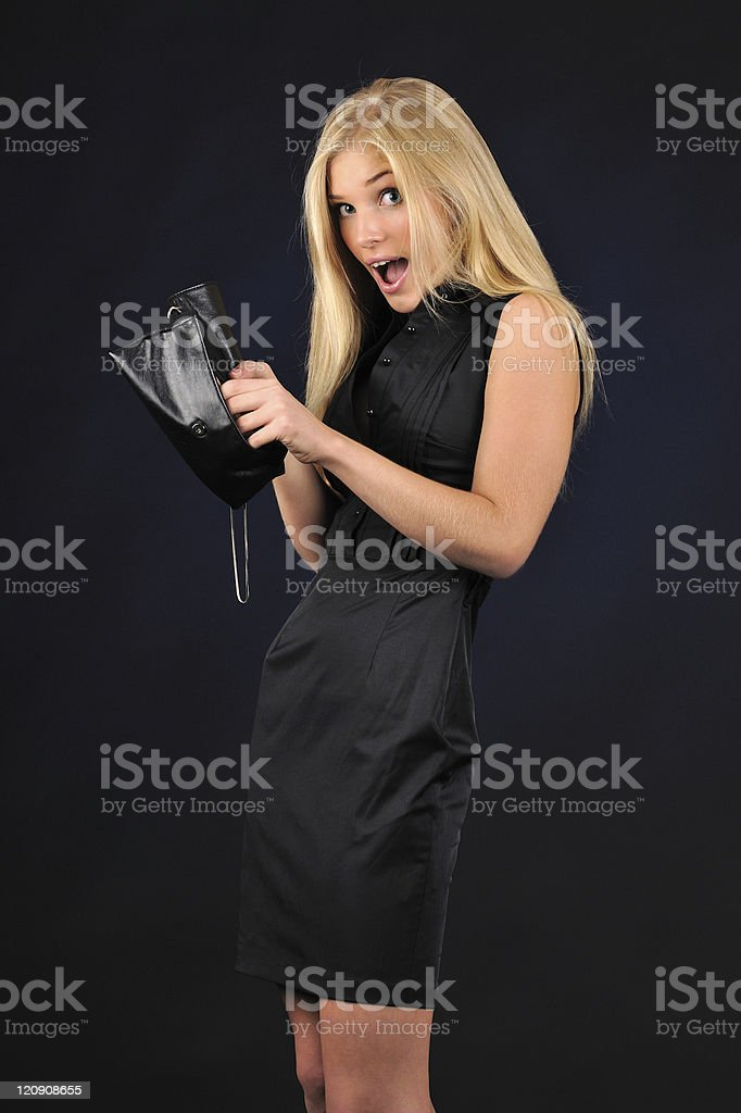 Woman with the purse royalty-free stock photo