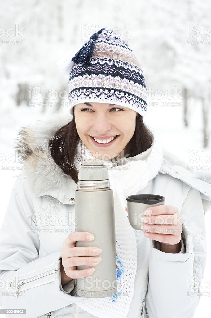 Woman with thermos and cup of tea or coffee royalty-free stock photo