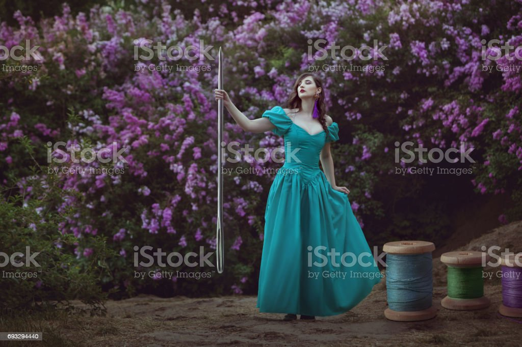 Woman with threads and a needle. stock photo