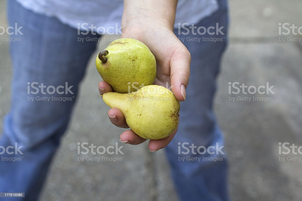 Woman with three pears royalty-free stock photo
