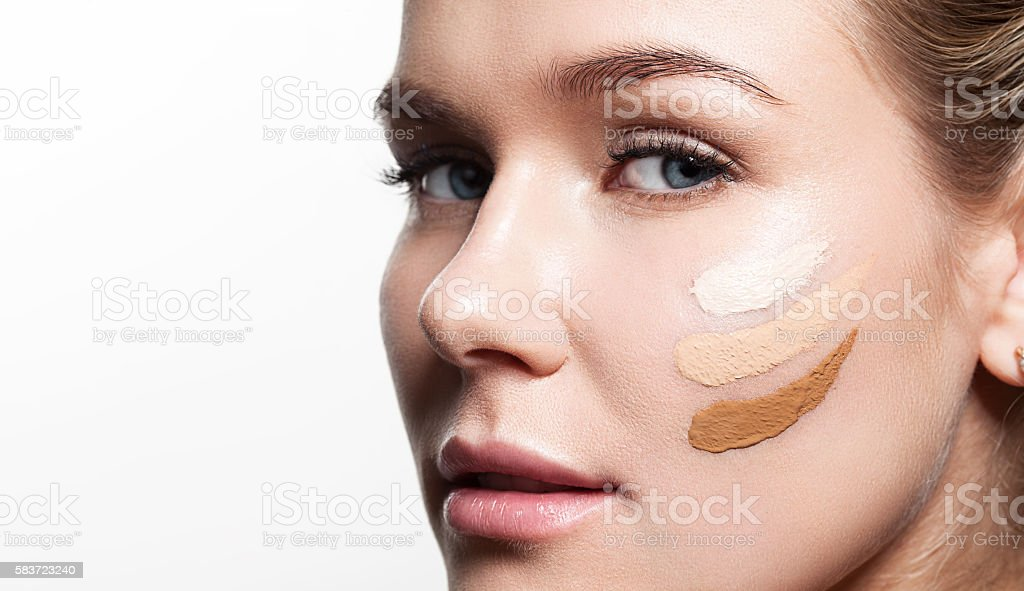 woman with three shades of foundation stock photo