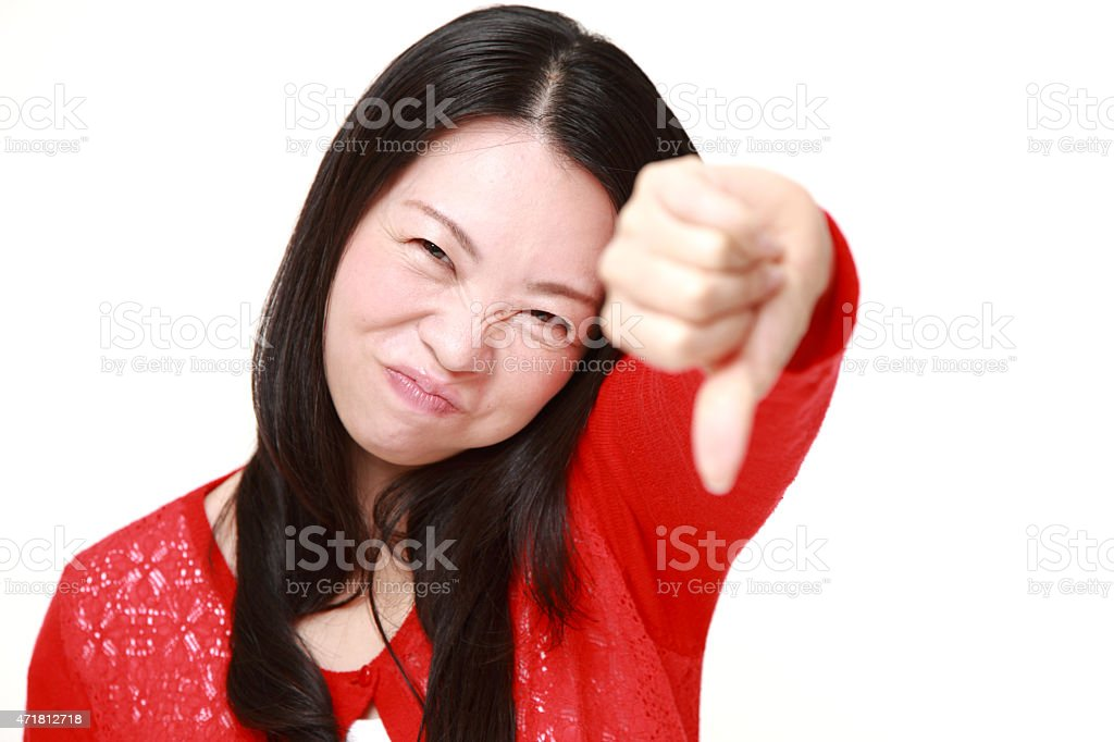 woman with thumbs down gesture stock photo