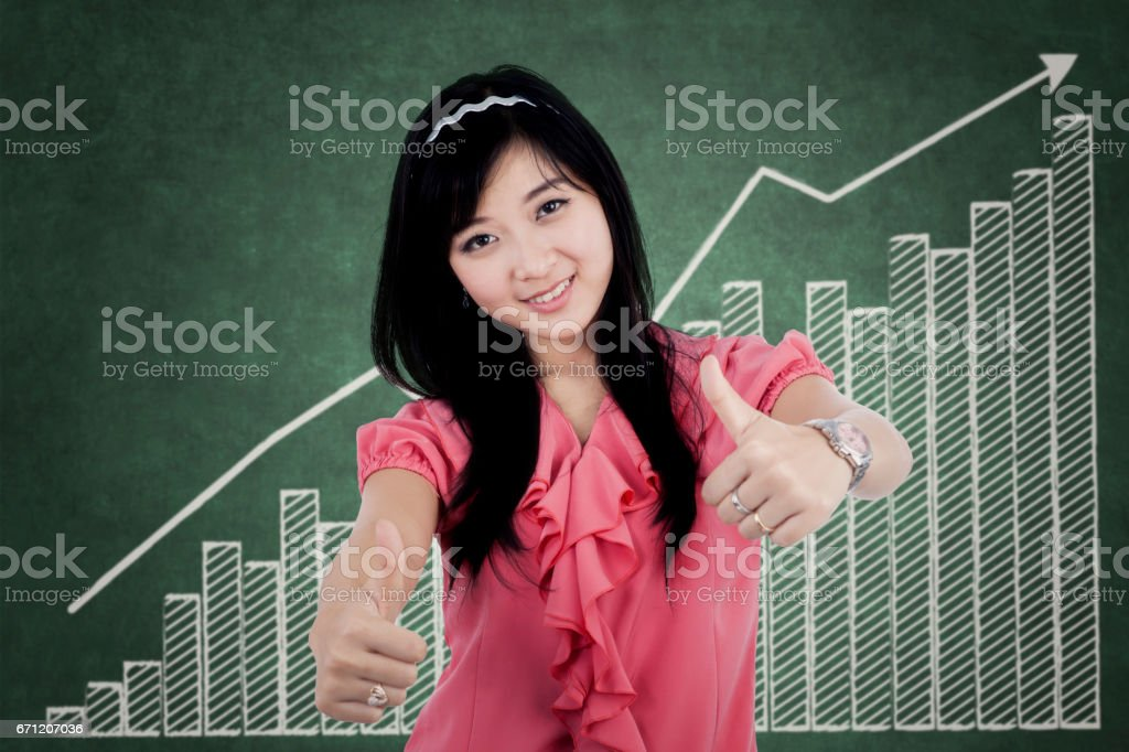 Woman with thumbs up and chart stock photo