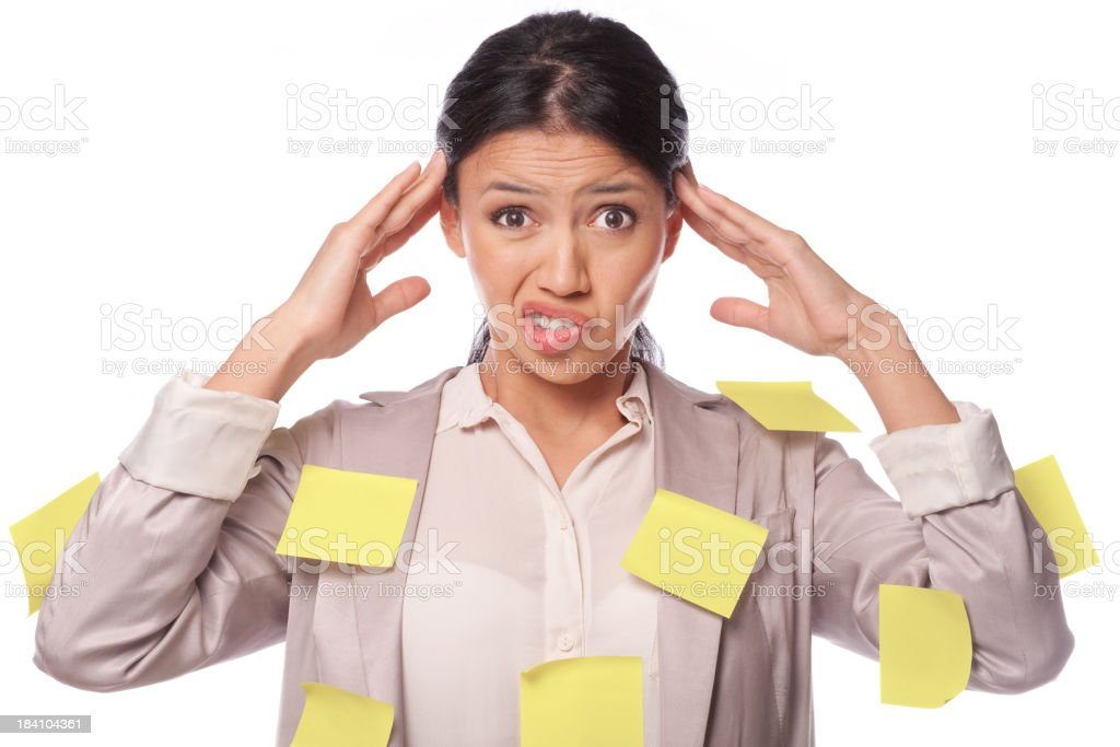 Woman with too much to do covered with many Post It notes royalty-free stock photo