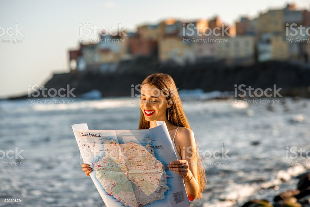 Woman with tourist map on Gran Canaria island stock photo