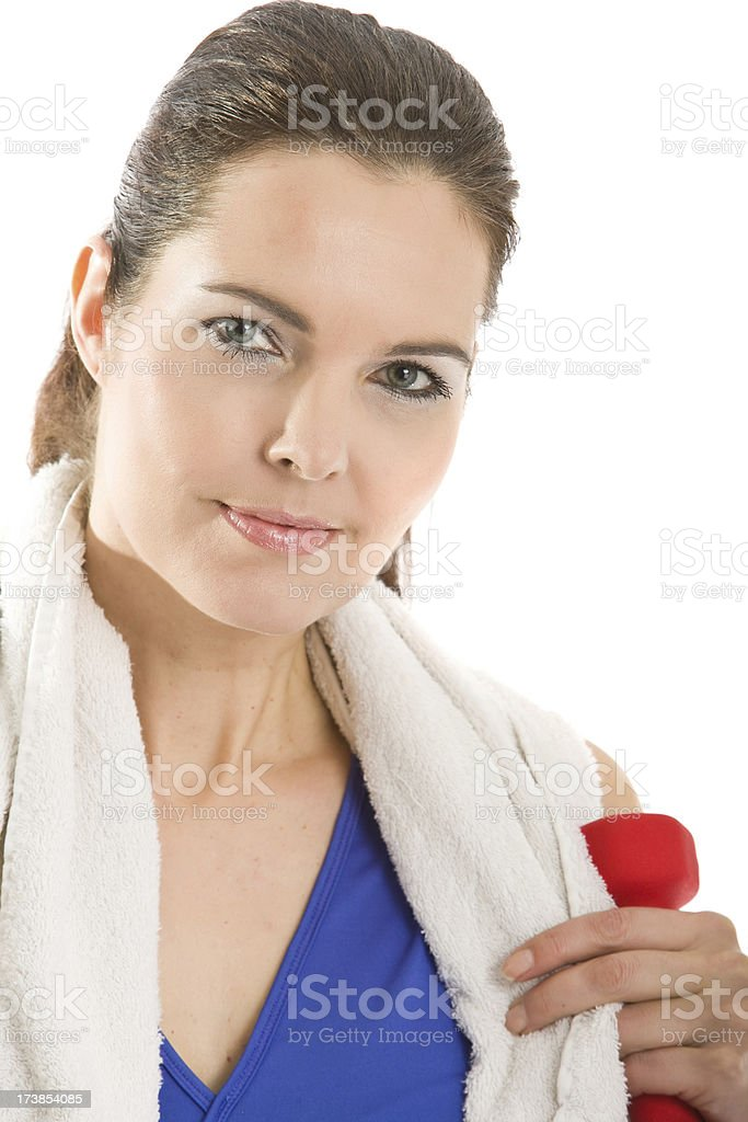 Woman with towel and dumbbell royalty-free stock photo