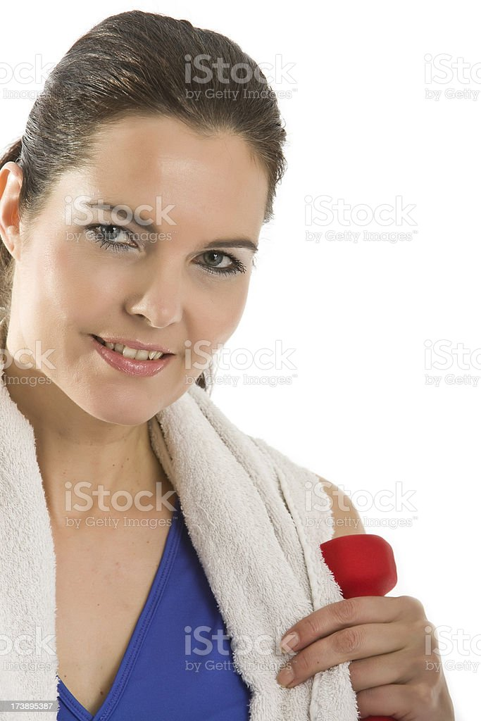 Woman with towel and dumbbell stock photo