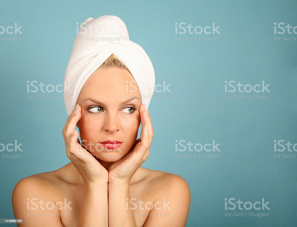 Woman With Towel on Head Waiting for Spa Technician royalty-free stock photo