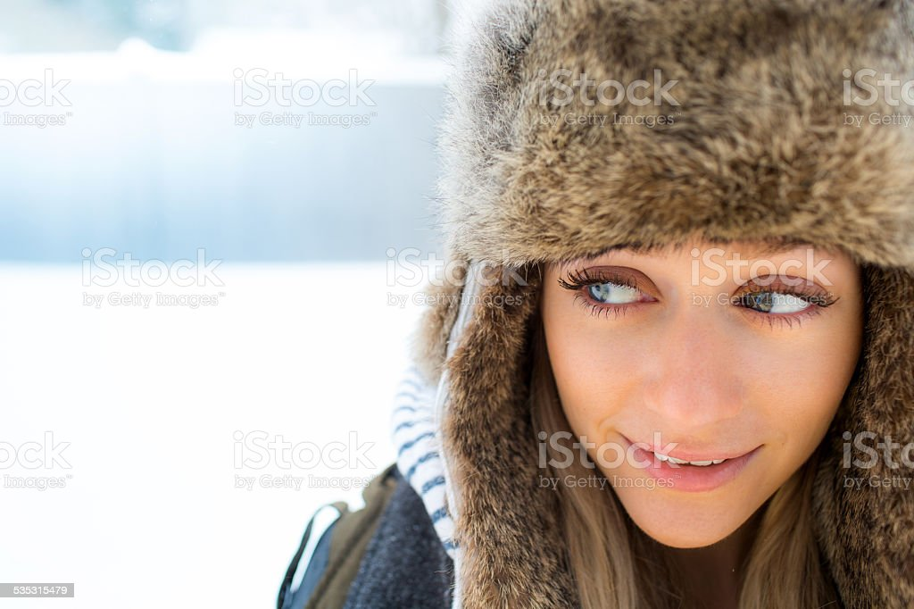 Woman with Trapper hat in winter stock photo