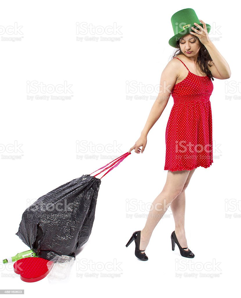 Woman with Trash Bag Cleaning Up After a Holiday Party stock photo