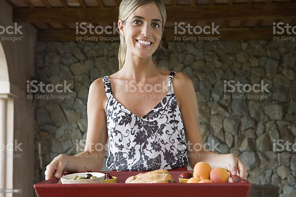 Woman with tray of food royalty-free stock photo