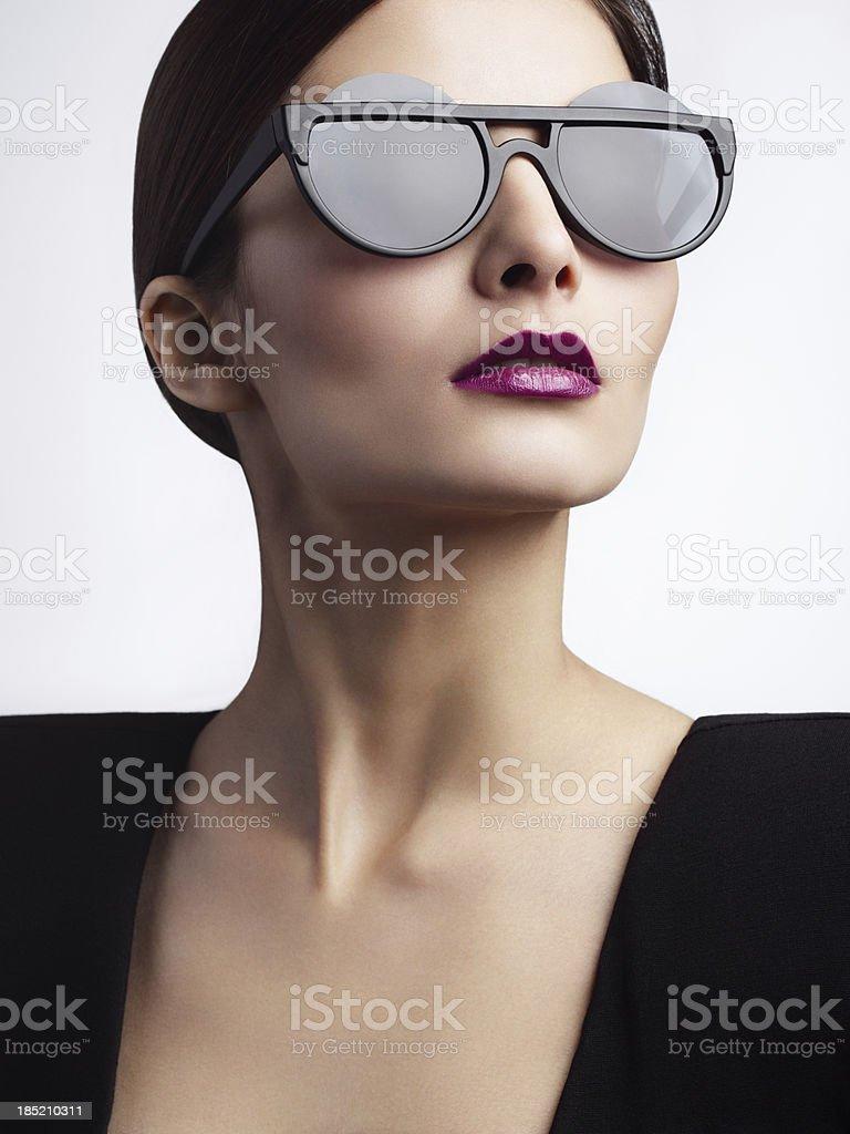 Woman with trendy eyewear royalty-free stock photo