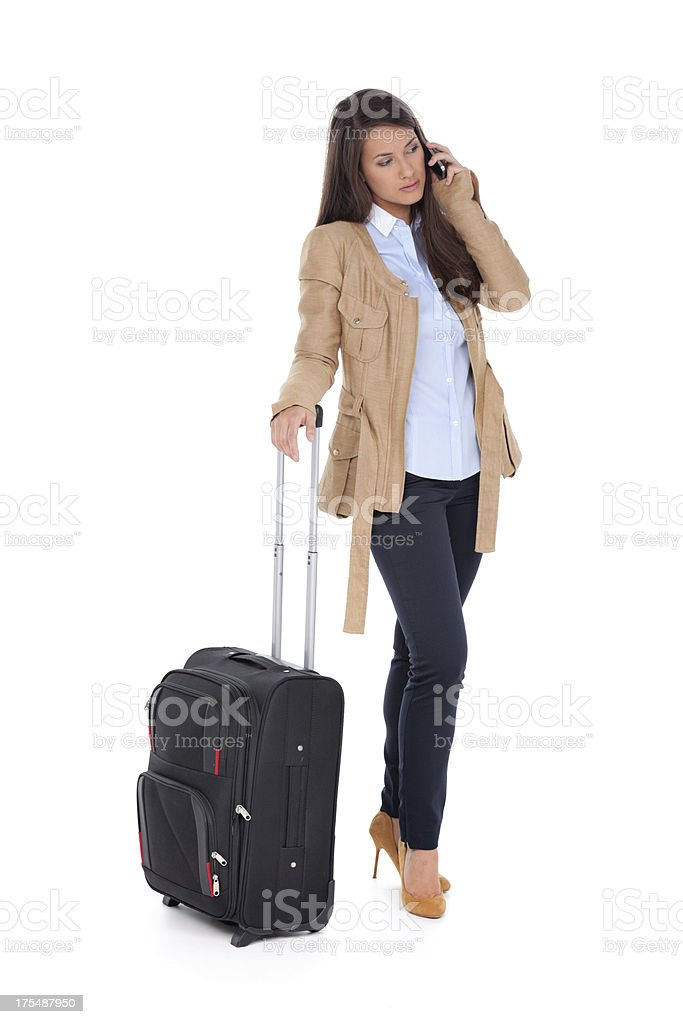 woman with trolley and phone waiting royalty-free stock photo