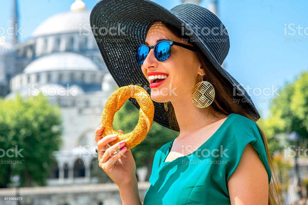 Woman with turkish bagel in Istanbul stock photo
