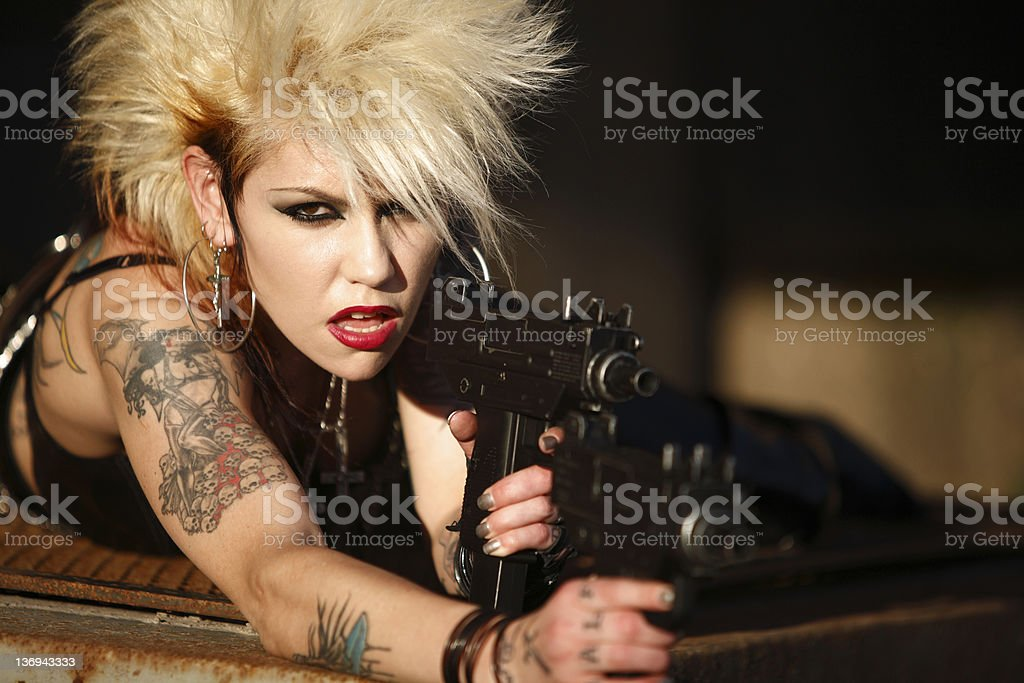 Woman with two guns royalty-free stock photo