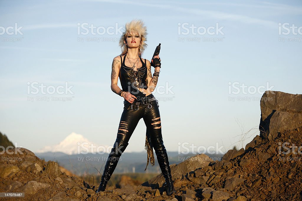 Woman with two guns stock photo