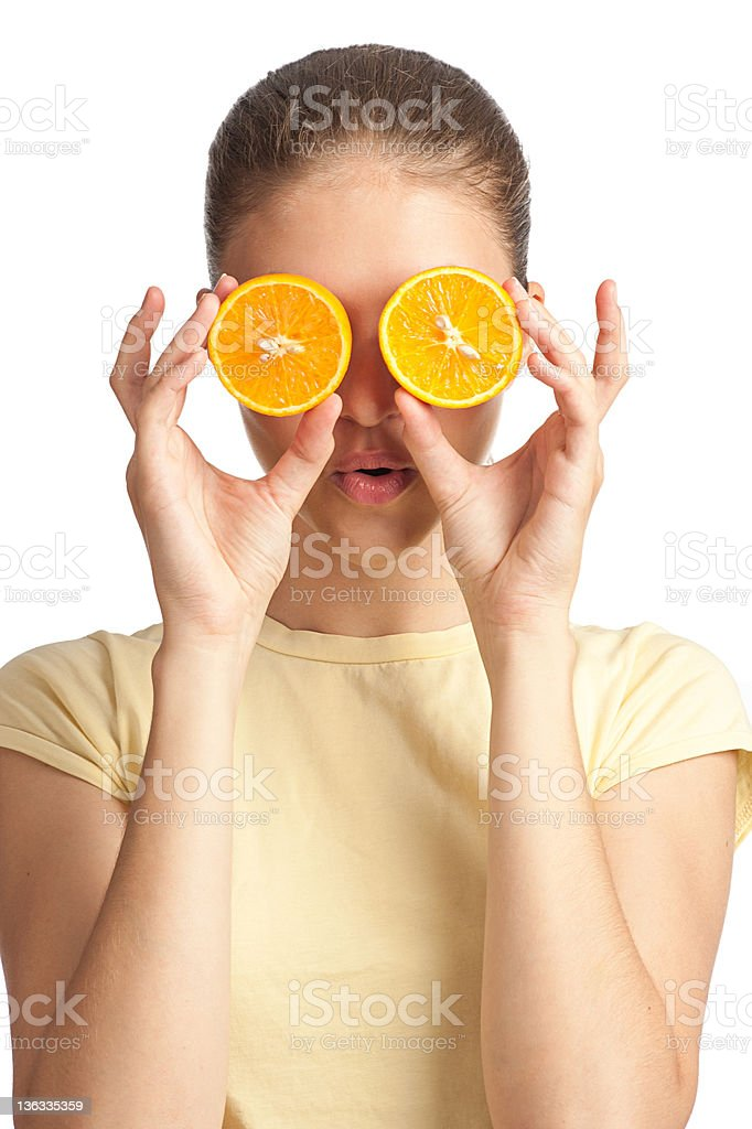 Woman with two halves of orange royalty-free stock photo
