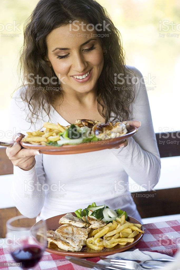 Woman with two plates of food XXL royalty-free stock photo