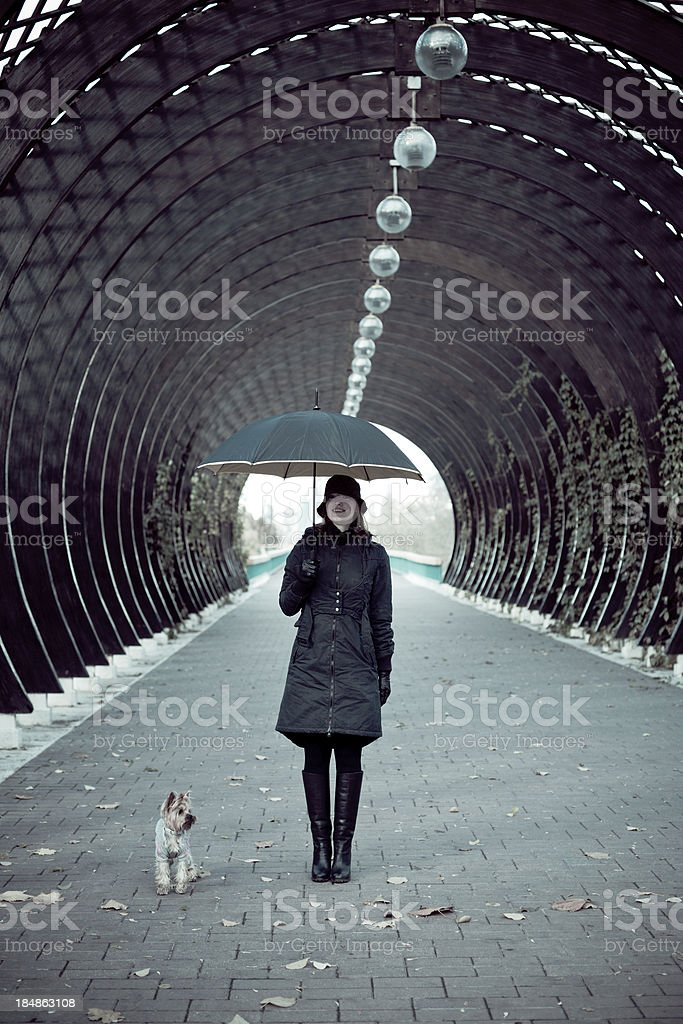 Woman with Umbrella and Dog royalty-free stock photo