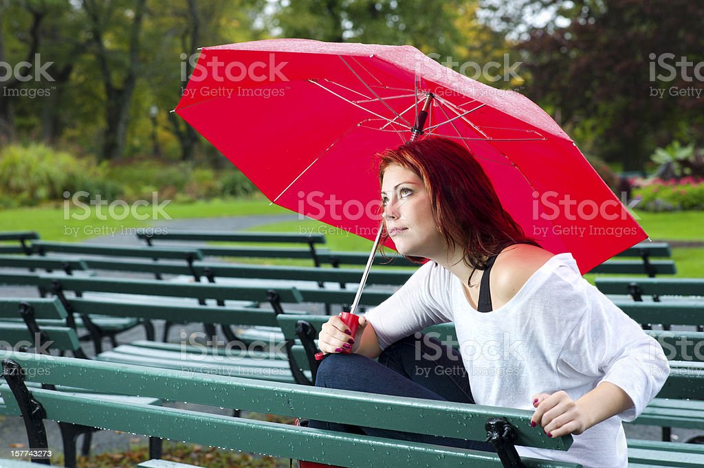 Woman with Umbrella Caught in the Rain. royalty-free stock photo