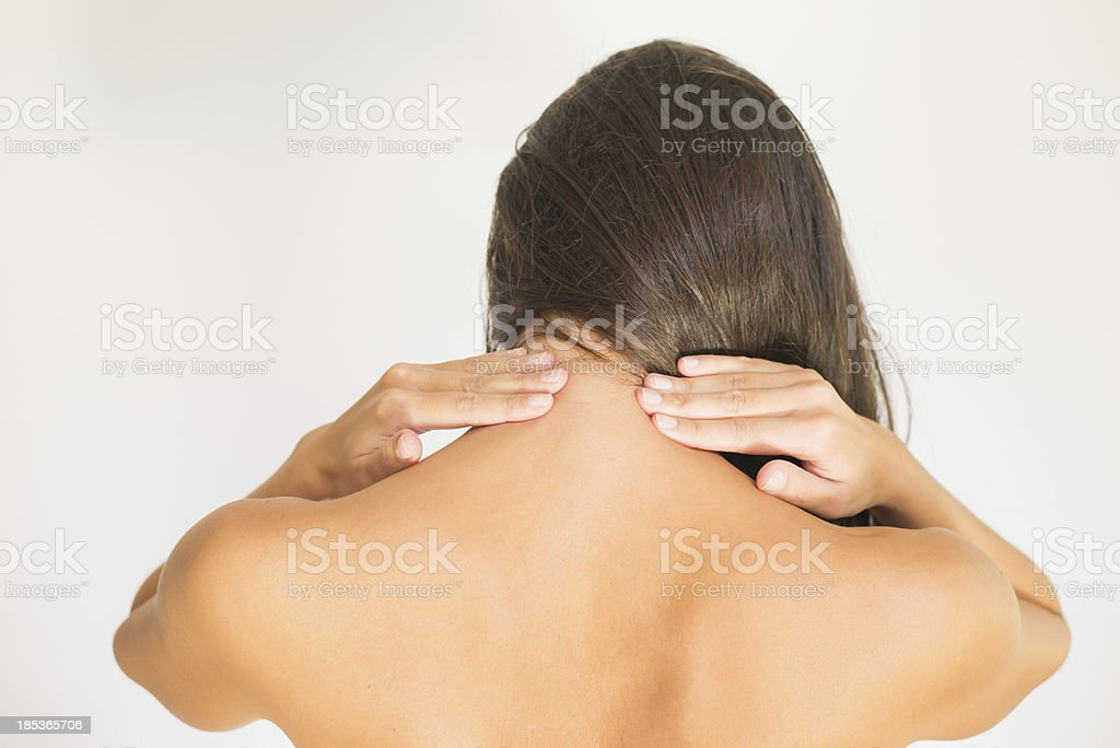 Woman with upper back and neck pain royalty-free stock photo