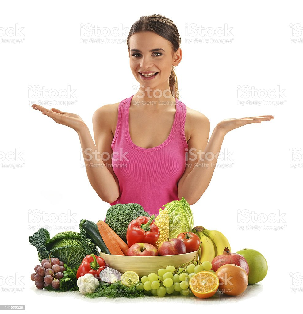Woman with variety of fruits and vegetables isolated on white royalty-free stock photo