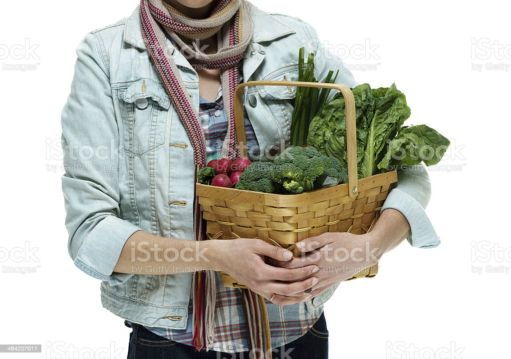 Woman with vegetable basket royalty-free stock photo