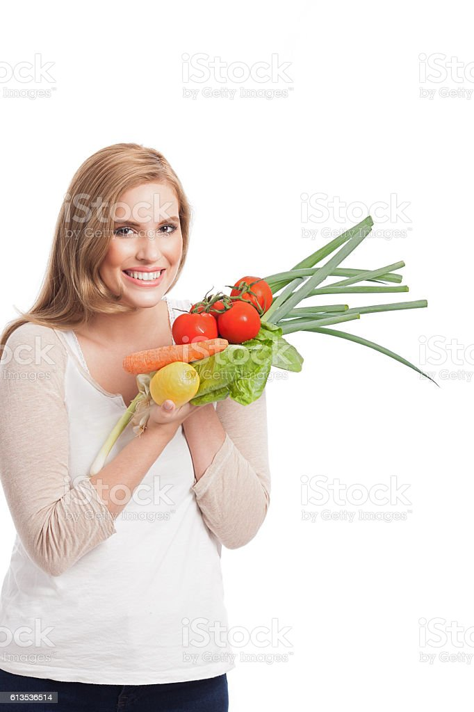 Woman with vegetables in hands. stock photo