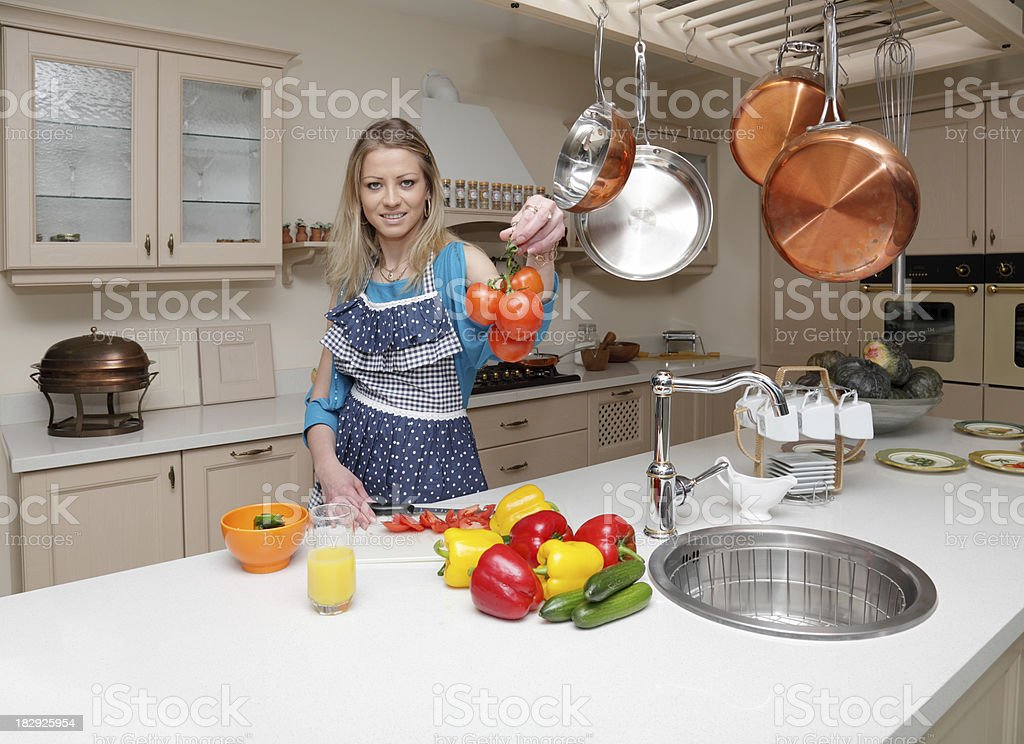 Woman with vegetables in the kitchen royalty-free stock photo