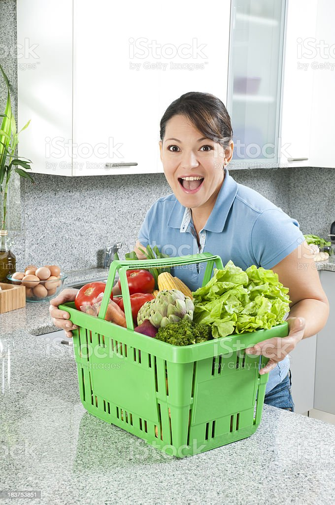 Woman with Vegetables Shopping Basket royalty-free stock photo