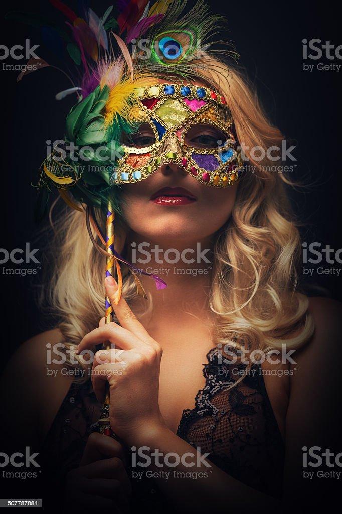 Woman with venetian mask stock photo
