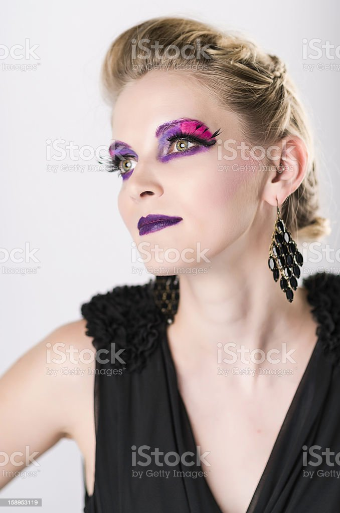 Woman with vibrant eye make-up royalty-free stock photo