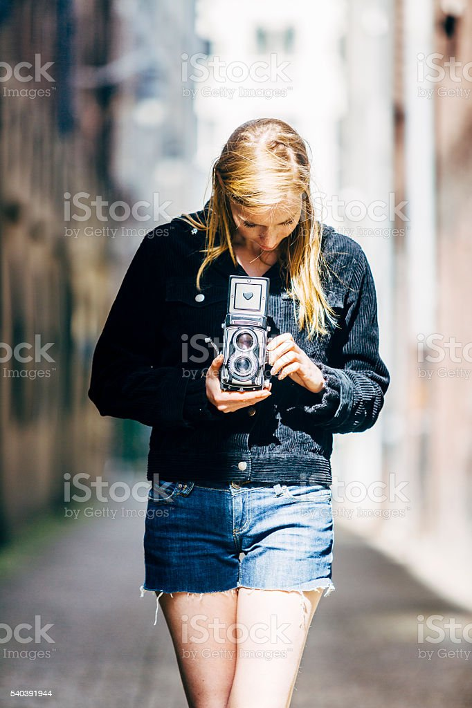 Woman with vintage camera stock photo