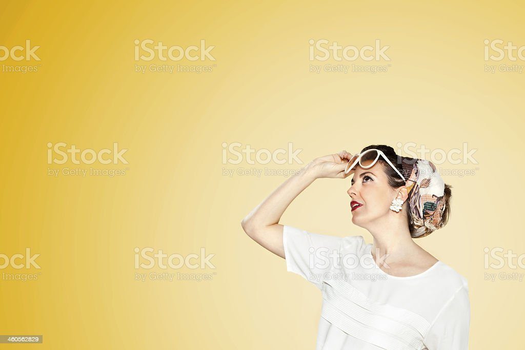 Woman with vintage glasses looking foward royalty-free stock photo