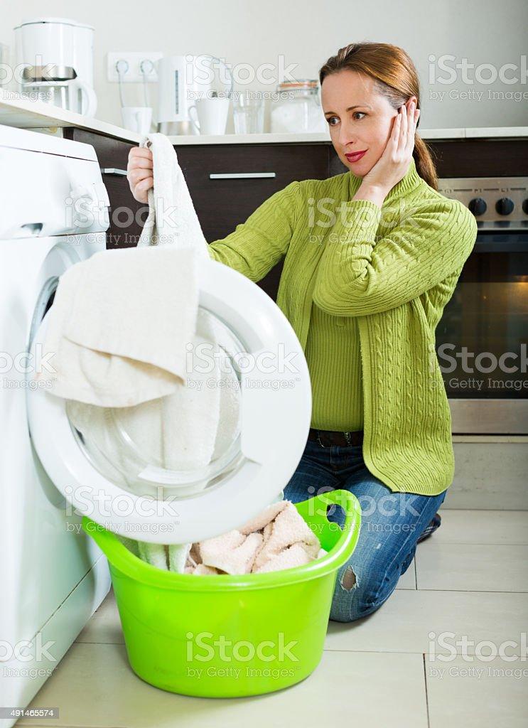 Woman with washing machine stock photo