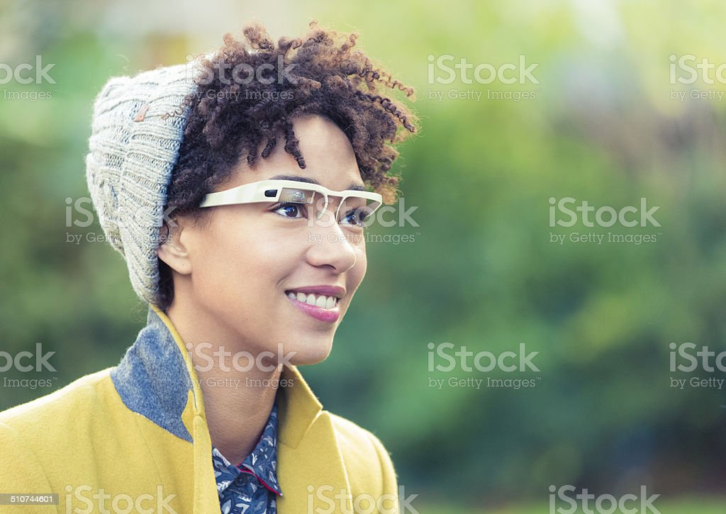 Woman with wearable computer in form of smart glasses. stock photo