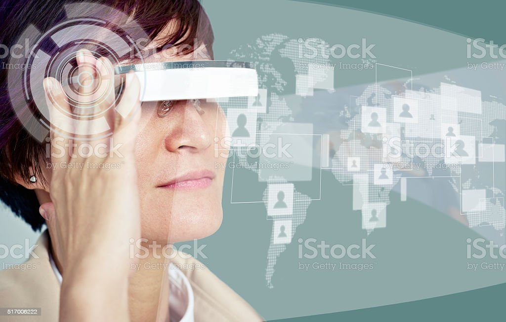 woman with wearable viewing device stock photo
