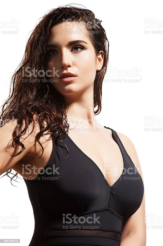 Woman with wet hair in a swimsuit stock photo