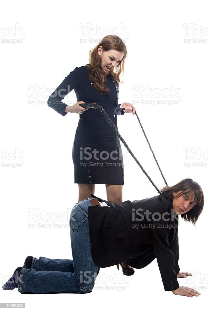 Woman with whip and man in jacket stock photo