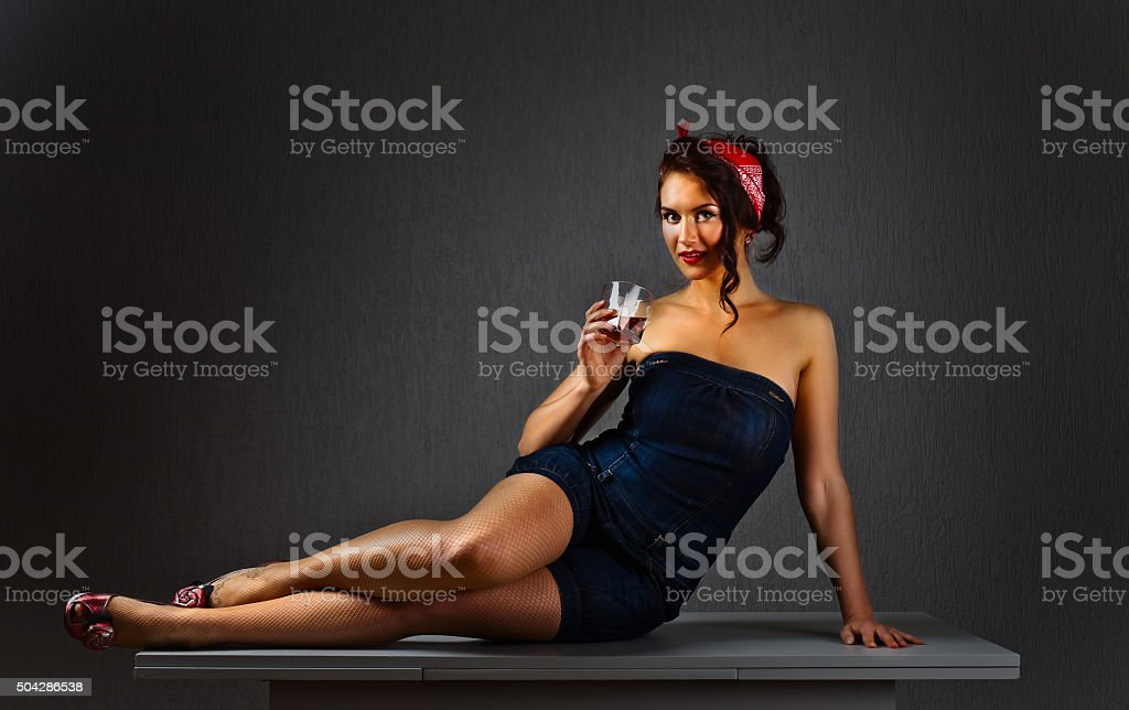 woman with whiskey stock photo